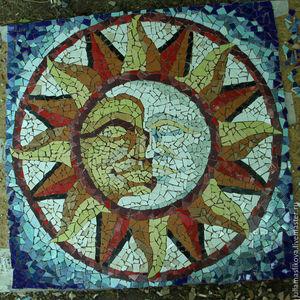 Символическое изображение солнца и луны